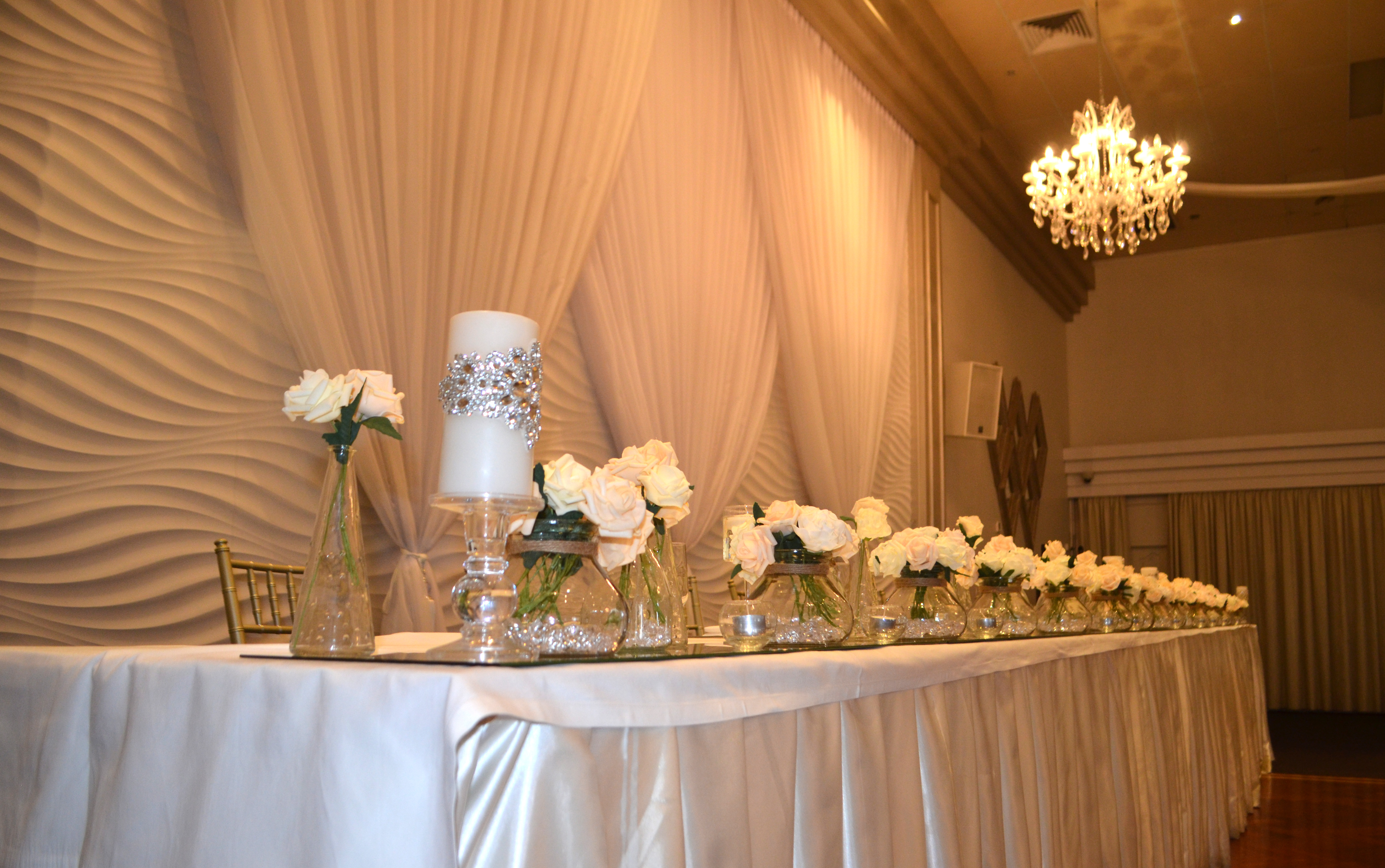Layered vases with Real Touch Roses and Encrusted Swarovski Beaded Candles at Novella Events 2