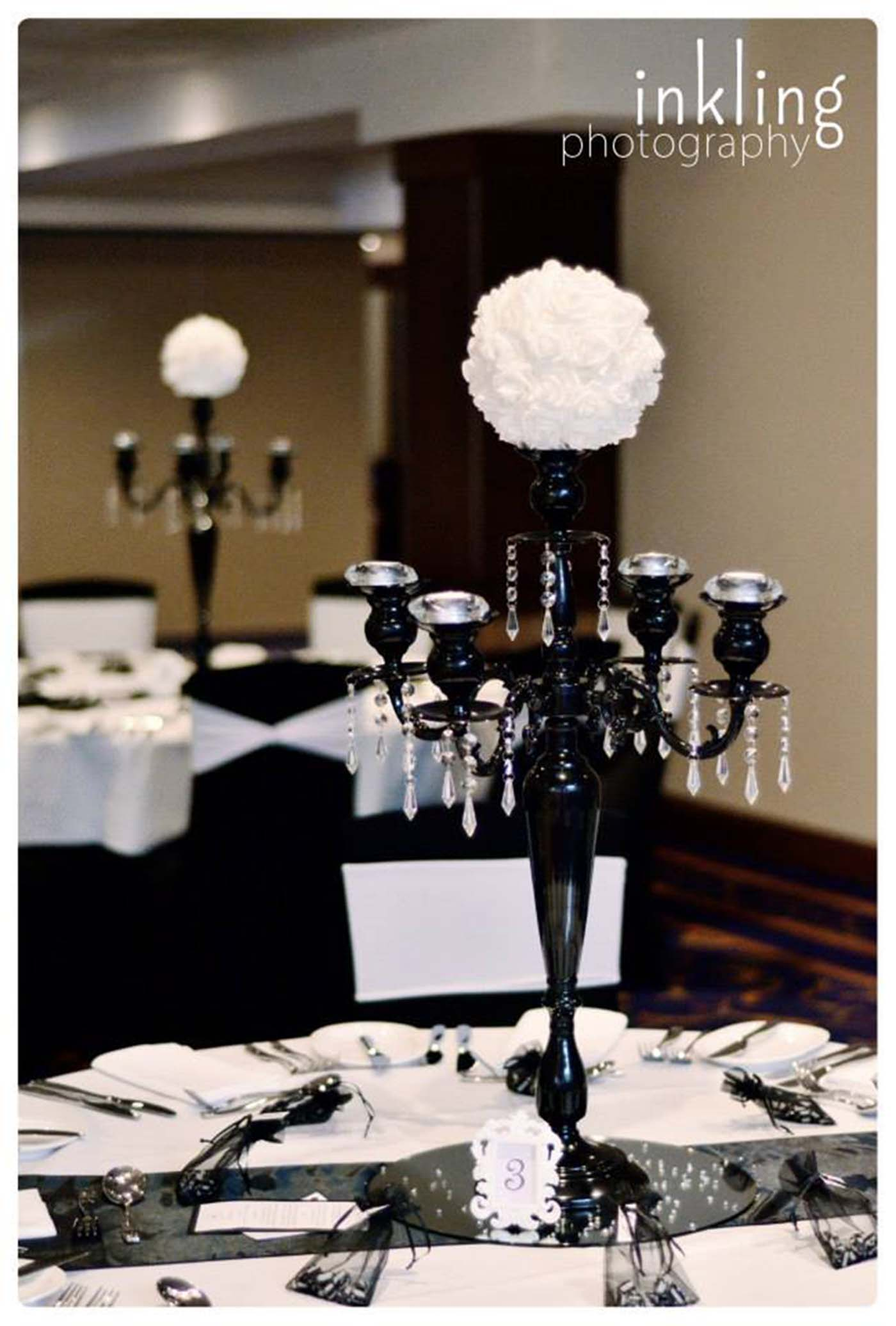 Black 5 arm candelabra with white artificial flower topper