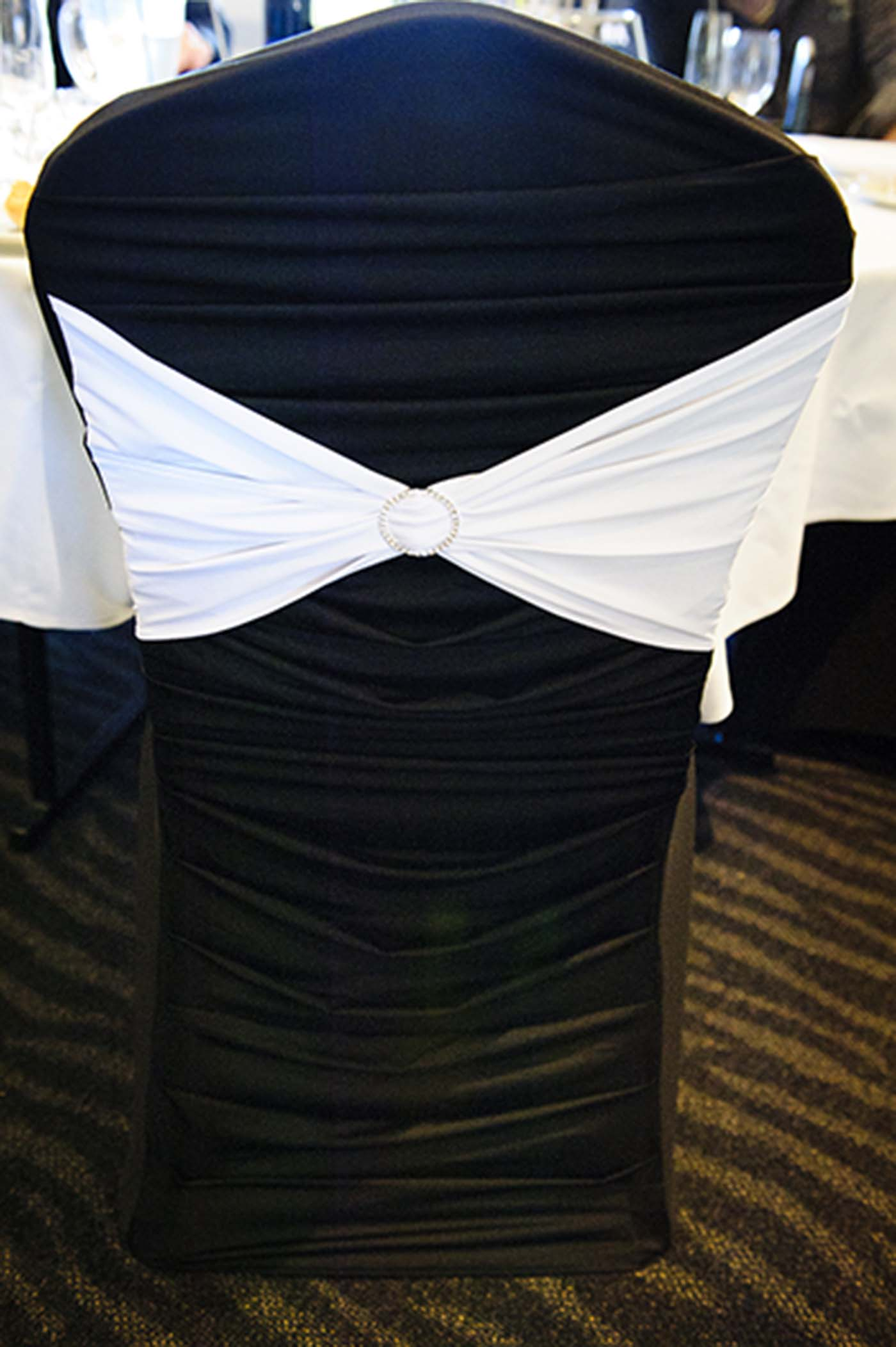 Black Pleated Designer Chair Cover with White Lycra Band and Diamonte Buckle