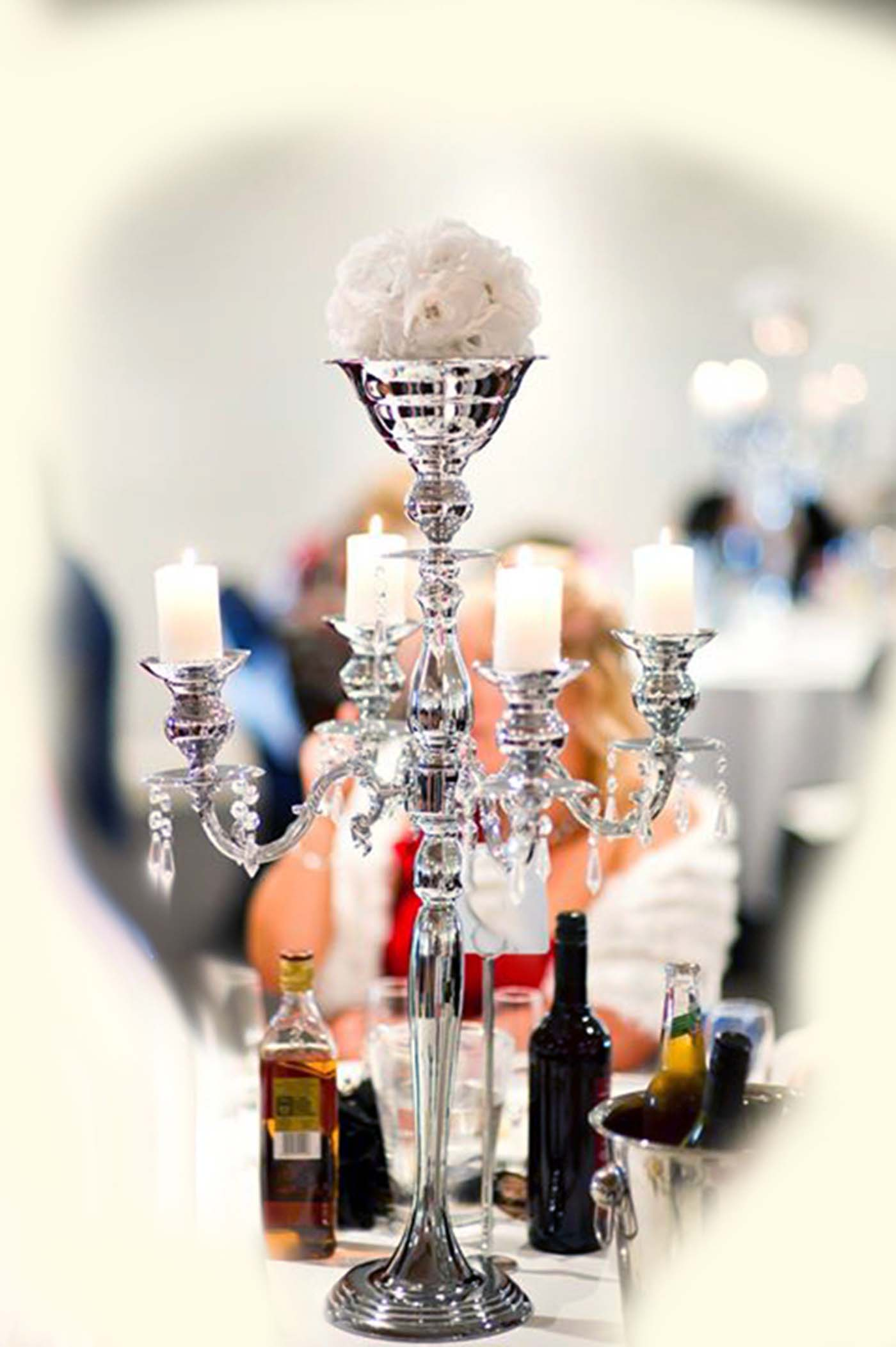 Chrome 5 arm candelabra with white artificial flower topper