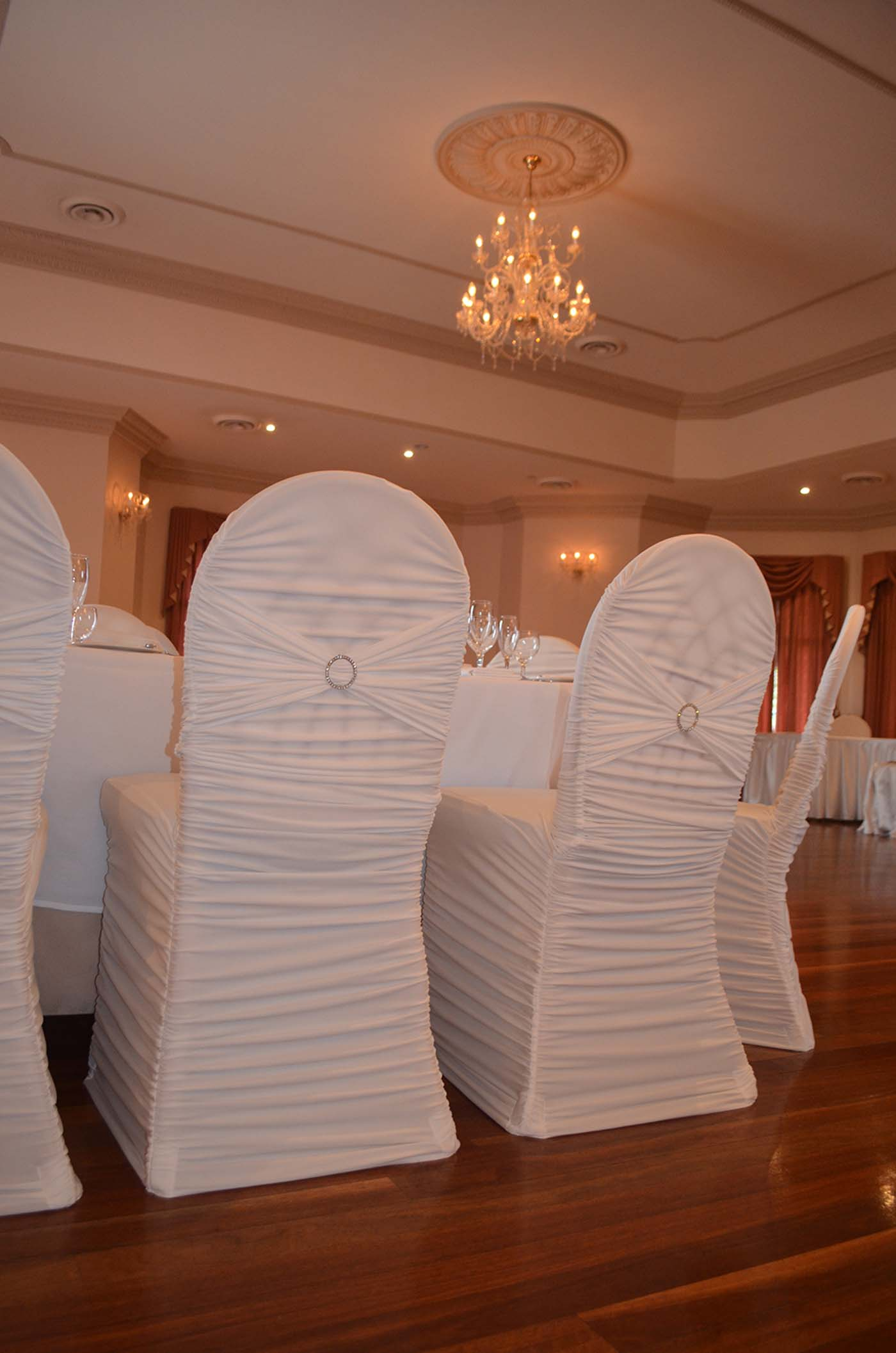 White designer pleated chair cover with diamonte buckle 3