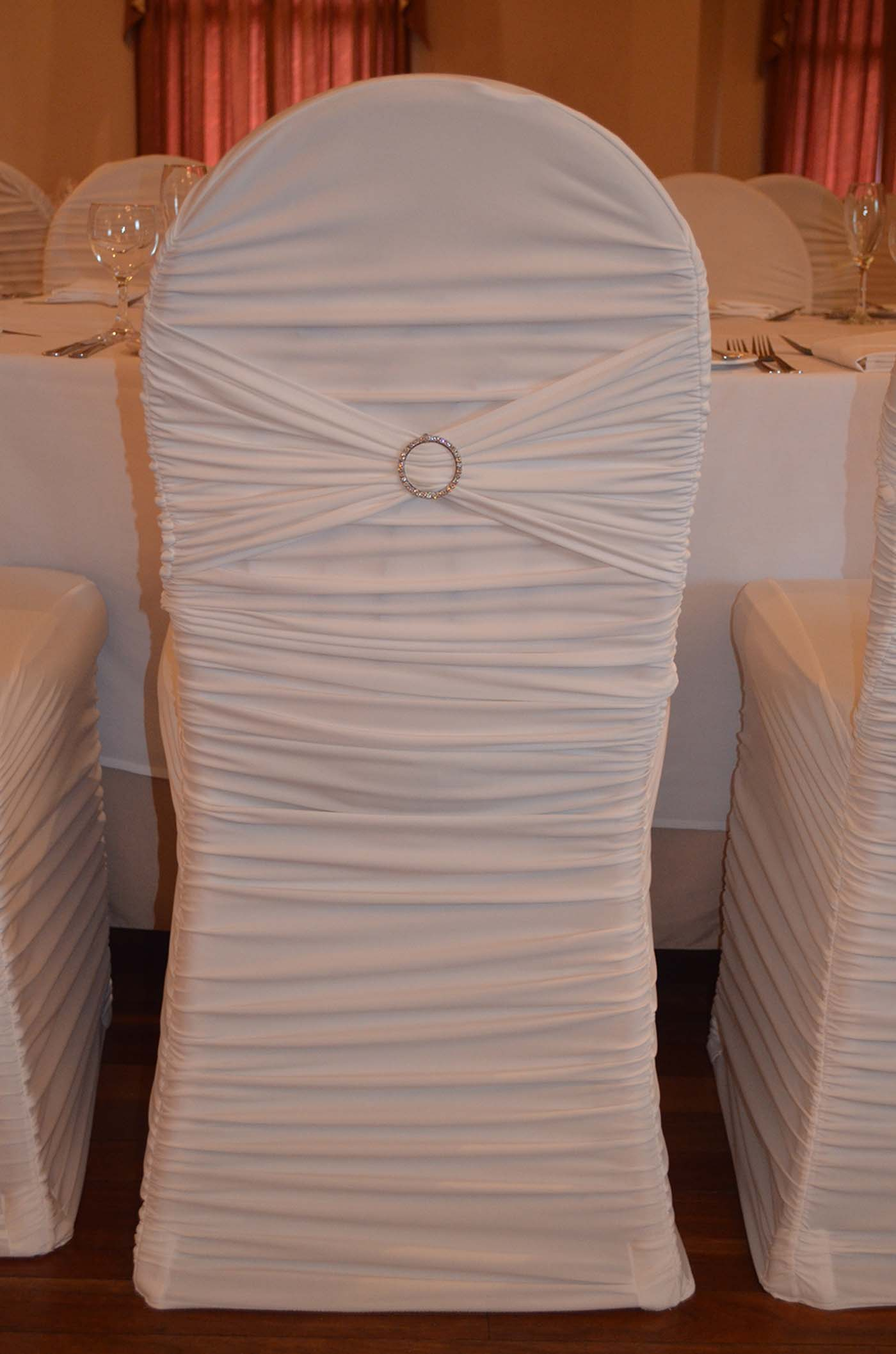 White designer pleated chair cover with diamonte buckle