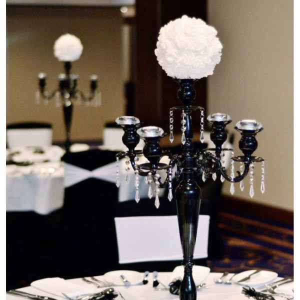 Black-5-arm-candelabra-with-white-artificial-flower-topper 1