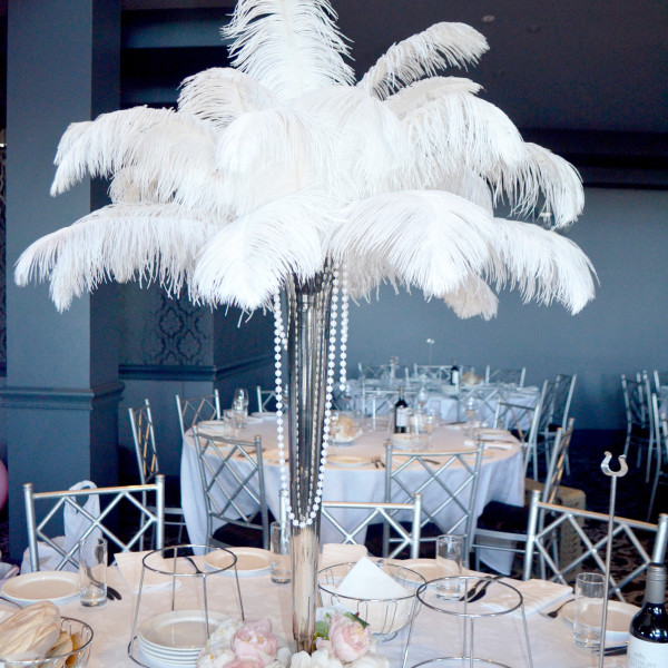 Silver Vase with White Ostrich Feathers and artificial peony's
