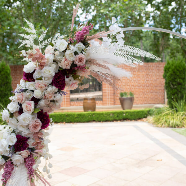 Boho white and pink floral arbour